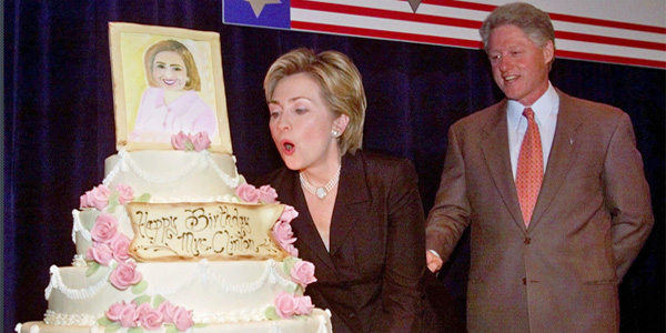 On her 52nd birthday, Hillary Clinton blows out candles on her birthday cake in 1999 as her husband, then-President Bill Clinton, looks on