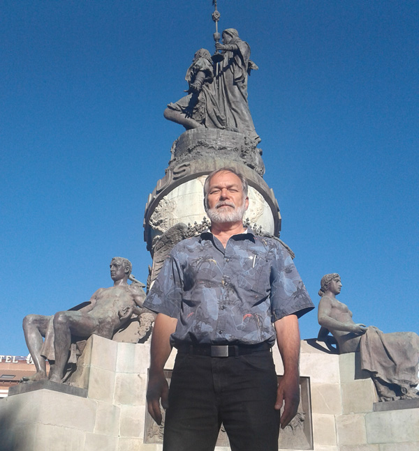 Pastor Lively at the massive monument to Christopher Columbus in Valladolid, Spain