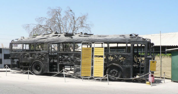 The charred remains of an Israeli bus, attacked by Palestinian terrorists in 1978 Coastal Road Massacre (Wikipedia).