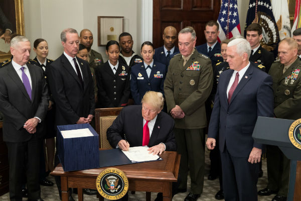 President Trump signs the National Defense Authorization Act Dec. 12, 2017 (Official White House photo by Stephanie Chasez)