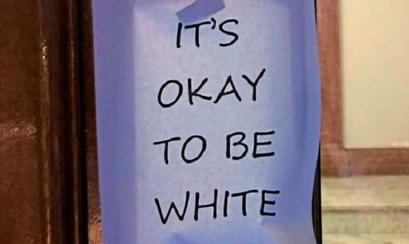 """It's OK to be white"" sign posted on door at University of Alberta"