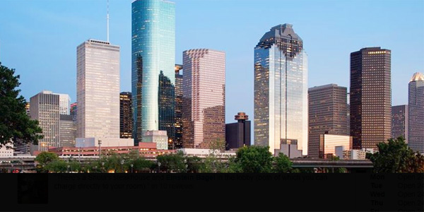 Houston, Texas, skyline. Hyatt Regency is the dark building near the middle with a copper-colored cylindrical restaurant atop its roof (Photo: Yelp)