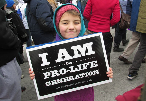 A young girl holds up a pro-life sign at the March for Life in Washington, D.C., in 2013 (Photo: Wikimedia Commons)