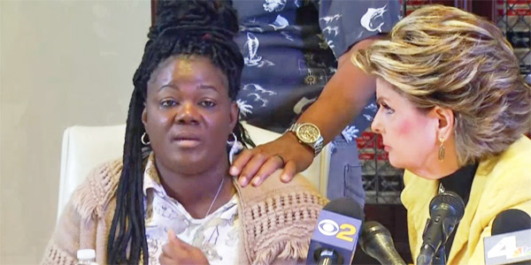 Essie Grundy holds a Jan. 26 news conference alongside celebrity attorney Gloria Allred during which they accuse Walmart of discrimination for locking up African-American hair products (Photo: Screenshot)