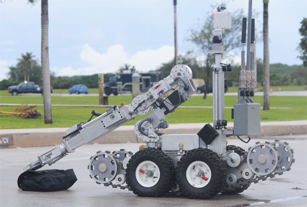 Remotely controlled bomb disposal robot, or REMOTEC F6A robot, used by U.S. Air Force to safely take suspicious packages to a safe location away from buildings and people (Photo: U.S. Air Force)