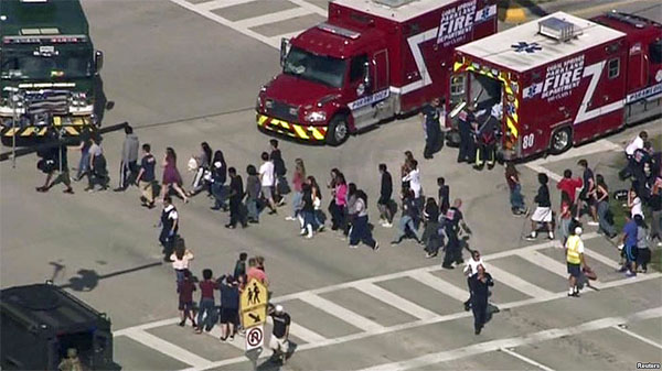 Students are evacuated from Marjory Stoneman Douglas High School during a mass shooting in Parkland, Florida (Photo: Voice of America)