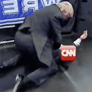 Trump pretends to body-slam CNN reporter in fake wrestling match (Photo: screenshot)