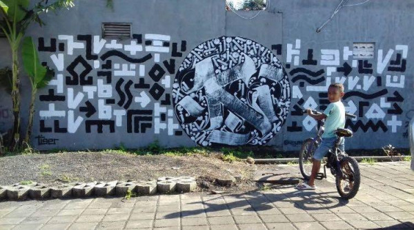 Boys checking out Artists 4 Israel mural done in Indonesia. Photo permission Craig Dershowitz