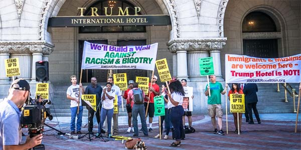 Protesters rally against Donald Trump outside Trump International Hotel in Washington, D.C., accusing him of racism and bigotry (Photo: Wikimedia Commons)