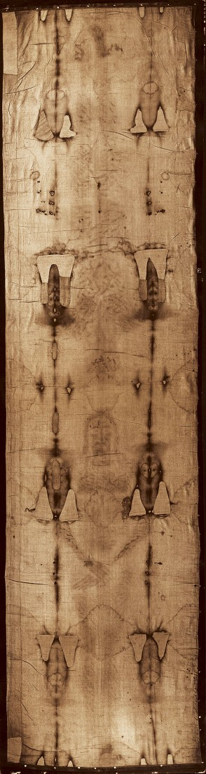 The Shroud of Turin (vertical position) how it looks to the naked eye. Marks running the length of the Shroud on both sides of the image are from a fire in 1532 that almost destroyed the Shroud. Credit: © 1978 Barrie M. Schwortz Collection, STERA. Inc. All Rights Reserved