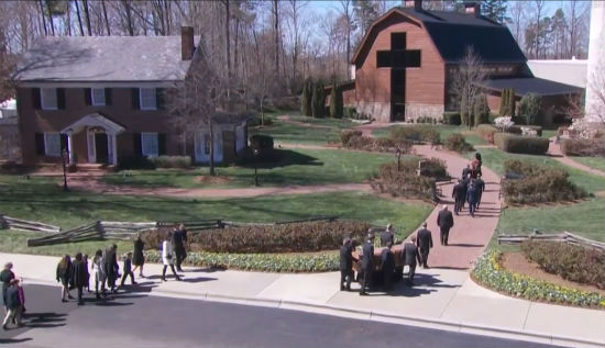 Casket bearing the body of Rev. Billy Graham is taken to burial plot next to his wife, Ruth, on the grounds of the Billy Graham Library in Charlotte, North Carolina, March 2, 2018.(Video screenshot)