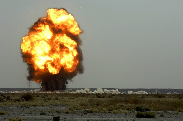 U.S. Air Force Airmen of the 407th Expeditionary Civil Engineer Squadron explosive ordnance disposal team conducts a controlled detonation on Ali Air Base, Iraq, Nov. 14, 2007. The Airmen unloaded just under 1,800 pounds of expired munitions to ensure they will not be used against U.S. forces. (U.S. Air Force photo by Airman 1st Class Jonathan Snyder) (Released)