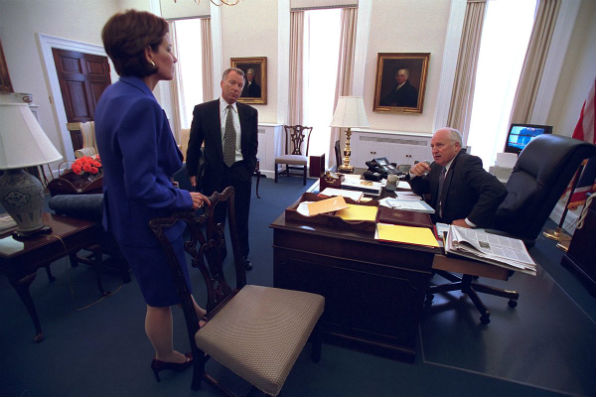 "Vice President Cheney talks with aides I. Lewis ""Scooter"" Libby and Mary Matalin (National Archives)"