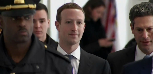 Facebook CEO Mark Zuckerberg prepares for testimony on Capitol Hill, April 10, 2018. (NBC video screenshot)