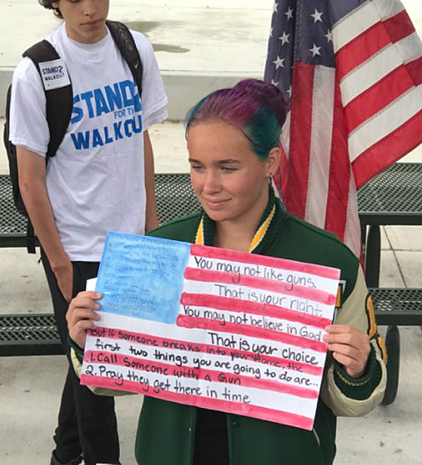 Teen student at Moorpark High School in California shows support for Second Amendment at May 2 walkout (Photo: Twitter)