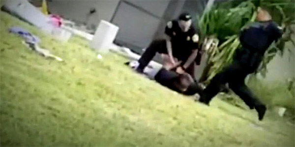 Miami police officer charged with assault denies kicking suspect