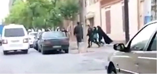 Iranian 'morality police' haul a woman off the street in Tehran (Video screenshot)