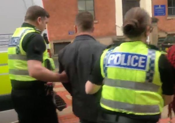 Tommy Robinson being led away by police in Britain