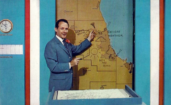 Postcard photo of television weatherman Harry Volkman on the WGN-TV news set (Wikimedia Commons)