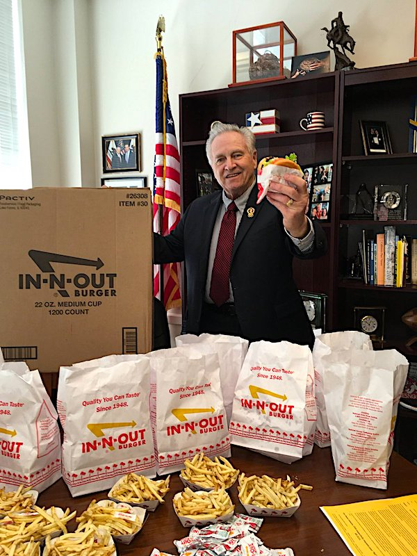 California Sen. Jim Nielsen shows off a large order of burgers and fries from In-N-Out Burger on Aug. 30, 2018