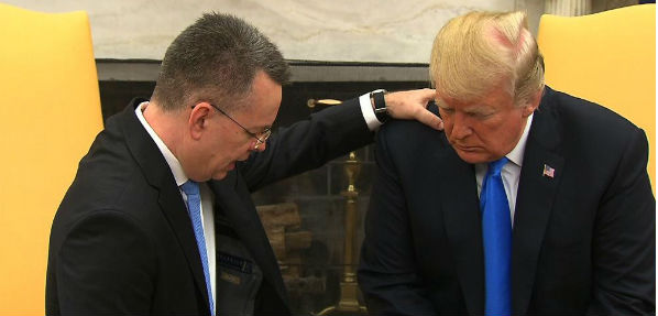 Pastor Andrew Brunson prays for President Trump in the Oval Office after his return from Turkey.