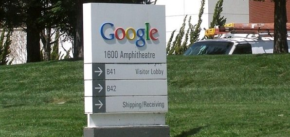 This sign welcomes visitors to the main building of the Googleplex (Google's company headquarters) at 1600 Amphitheatre Parkway in Mountain View, California. (Coolcaesar, Wikimedia Commons)