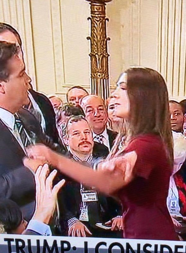 Jim Acosta grapples with a White House staffer trying to take the microphone from him at a presidential news conference Nov. 7, 2018