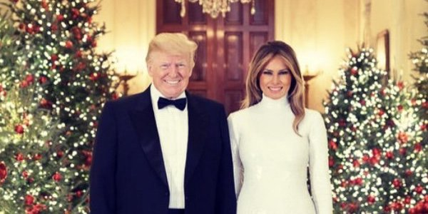 President Donald J. Trump and First Lady Melania Trump are seen Saturday, Dec. 15, in their official 2018 Christmas portrait, in the Cross Hall of the White House in Washington, D.C. (Official White House Photo by Andrea Hanks)