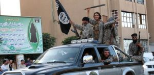 ISIS fighters parade through Raqqa, Syria, in 2014 (Wikimedia Commons)