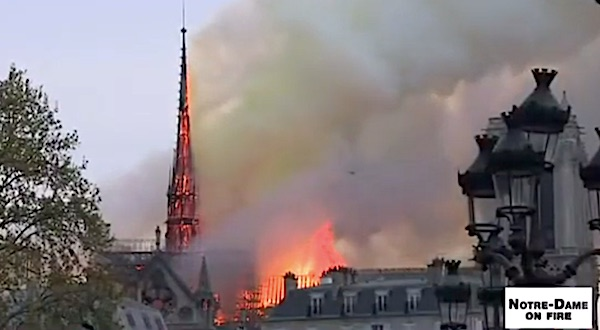 The spire of Notre Dame Cathedral in Paris, France, burns on April 15, 2019 (France24 video screenshot)