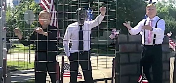 Likenesses of Hillary Clinton and Barack Obama in a cage with President Donald Trump free on the outside (KSFY-TV video screenshot)