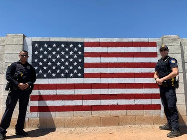 Phoenix police officers restore vandalized flag mural