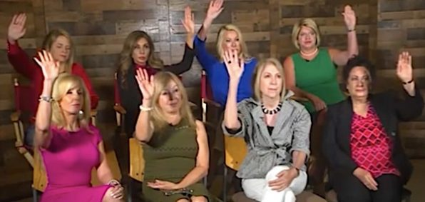 Eight Republican women on a CNN panel in Dallas, Texas, July 17, 2019, all raise their hands to indicate President Donald Trump is not a racist (CNN video screenshot)