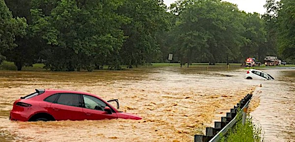 Cars were captured on camera driving through a flooded roadway on Riffle Ford Road in Germantown, Md., on Monday, July 8, 2019. (Montgomery County Fire Rescue photo)