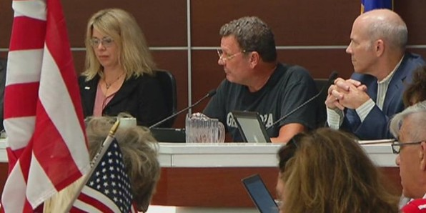 "The City Council of St. Louis Park, Minn., eliminated saying the Pledge of Allegiance before its meetings in a bid to ""diversity."" (KSTP-TV screenshot)"