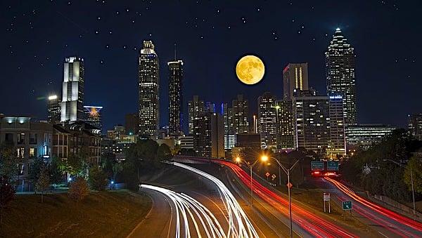 atlanta-georgia-city-night-stars-skyline-full-moon-traffic-highways-cars-roads.jpg