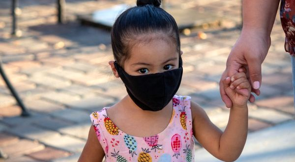 A year after we learned COVID rarely harms kids, Biden official tells vaccinated parents to keep masks on to protect them