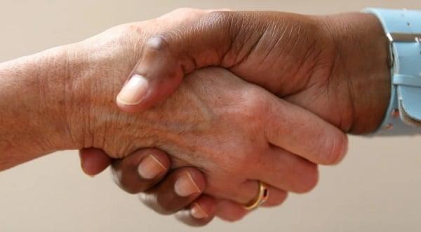 Major newspaper wants Americans to stop hugging, shaking hands